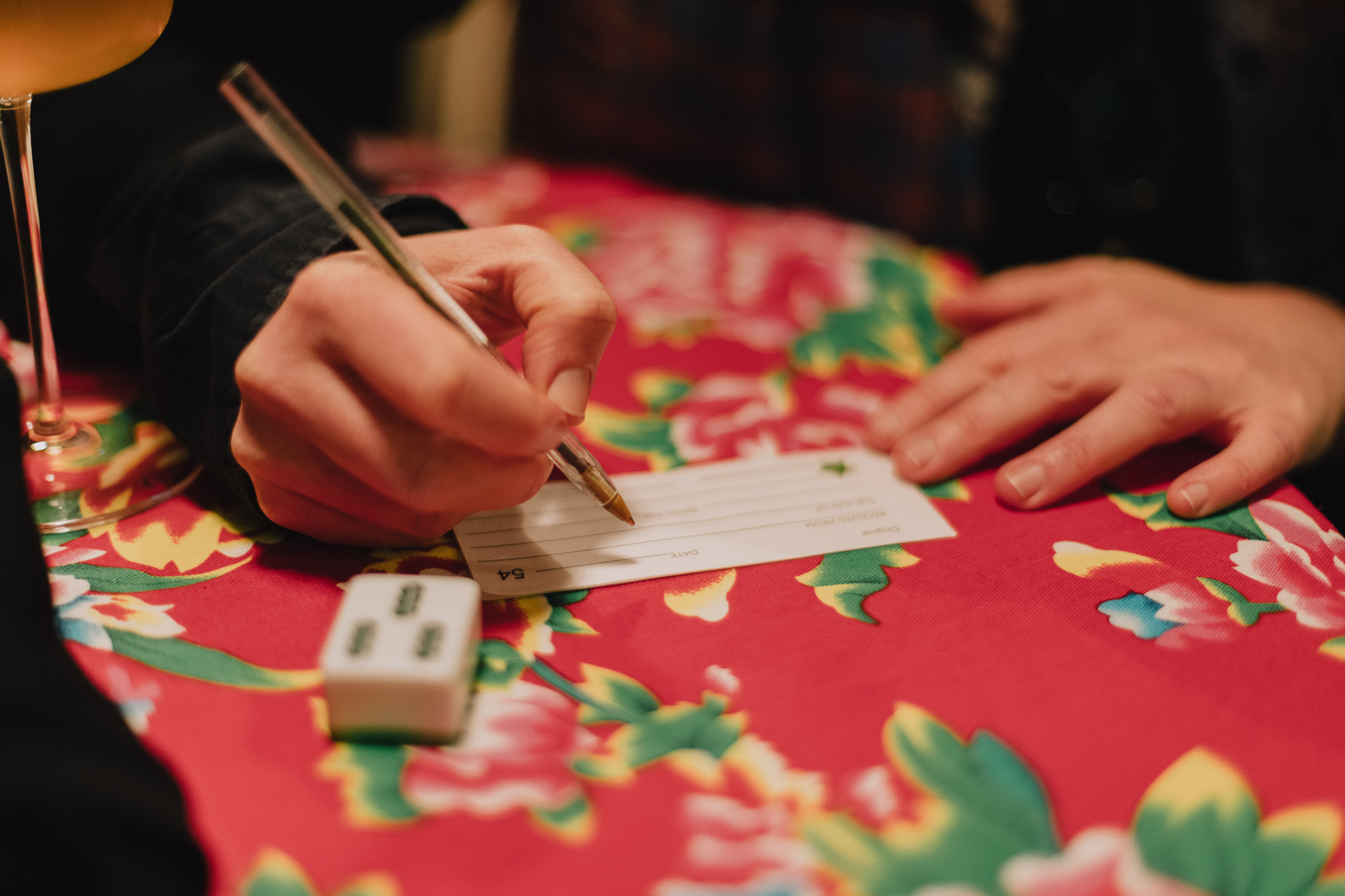 image of a hand writing a promise on a piece of paper