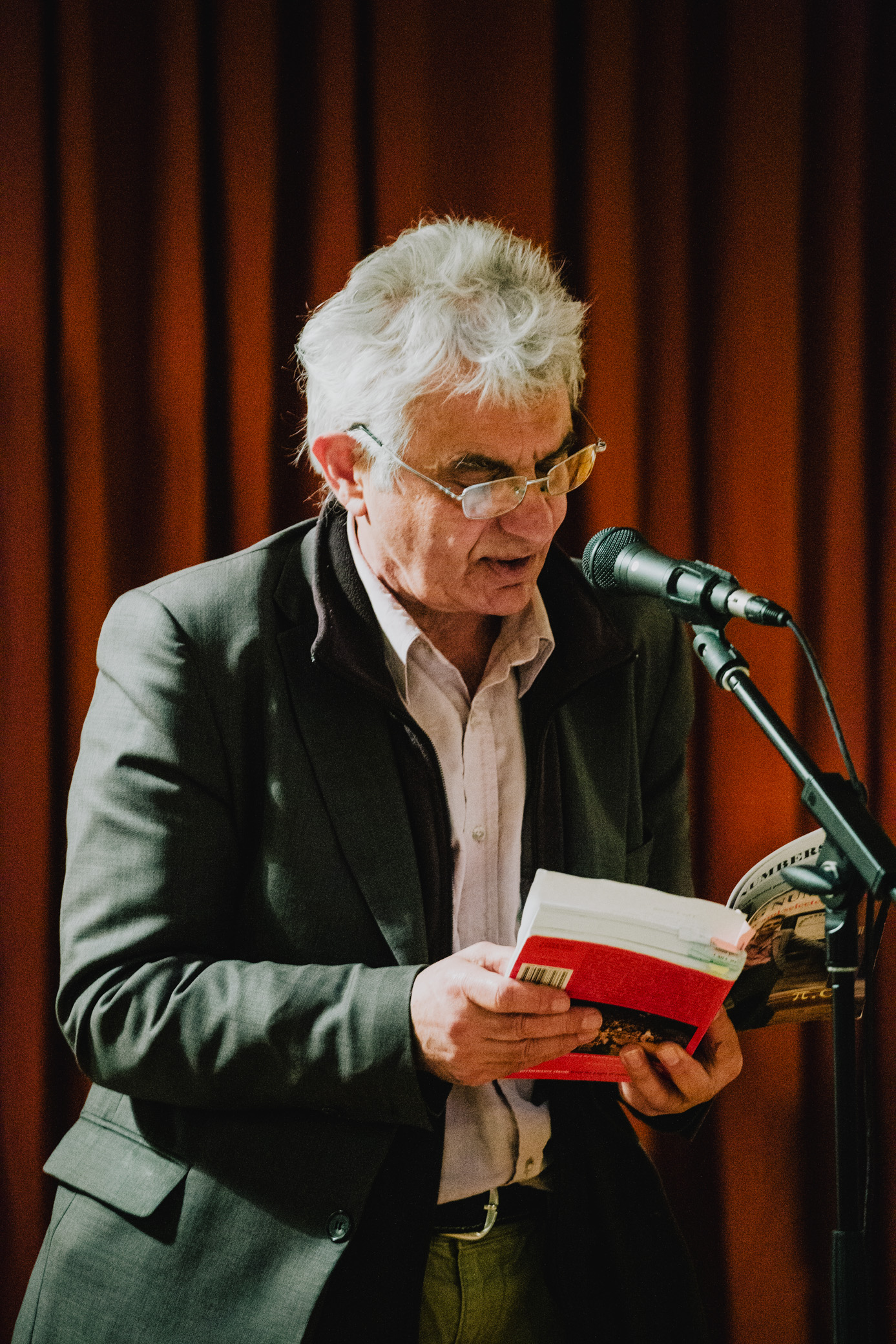 A poet reading from his book