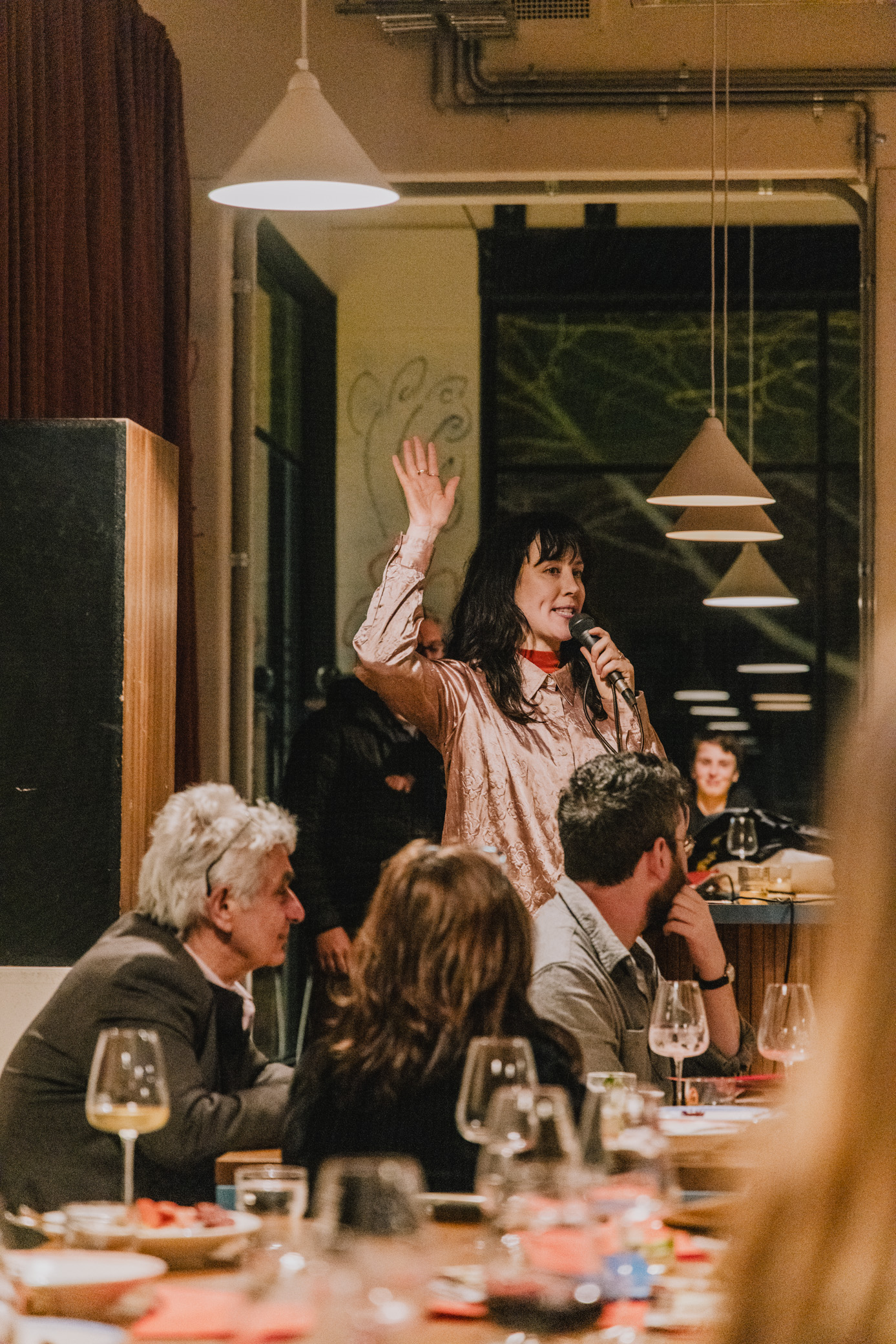 image a person waving their hand at the disorganising dinner