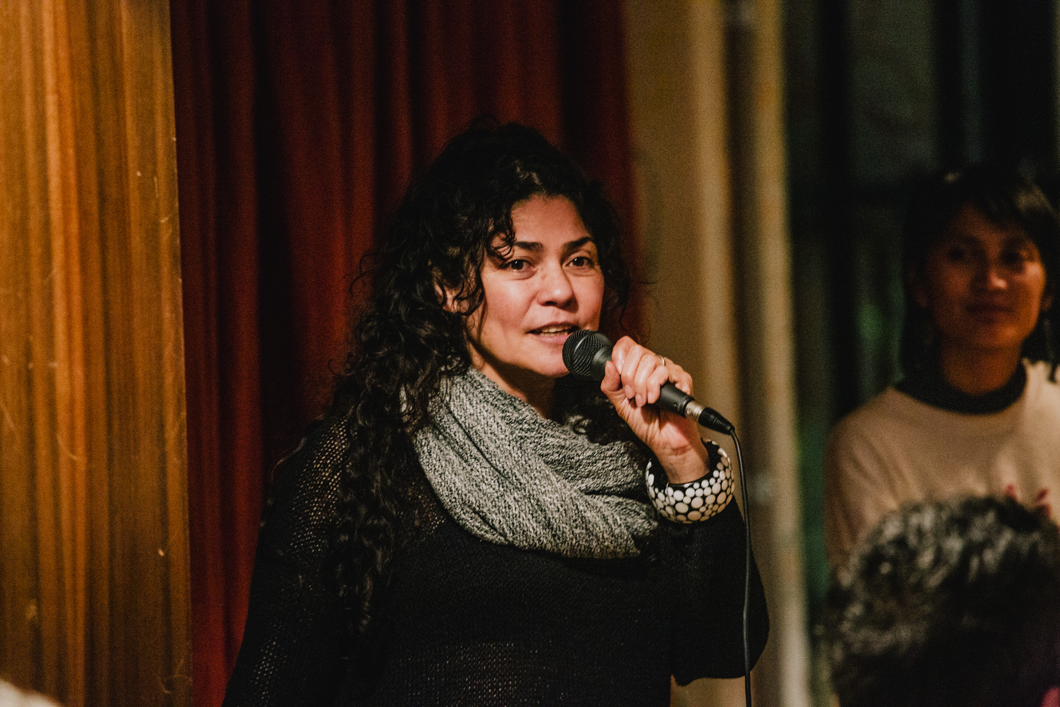 image of a person holding a mic