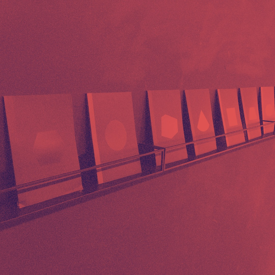 image of books on a shelf with a red filter