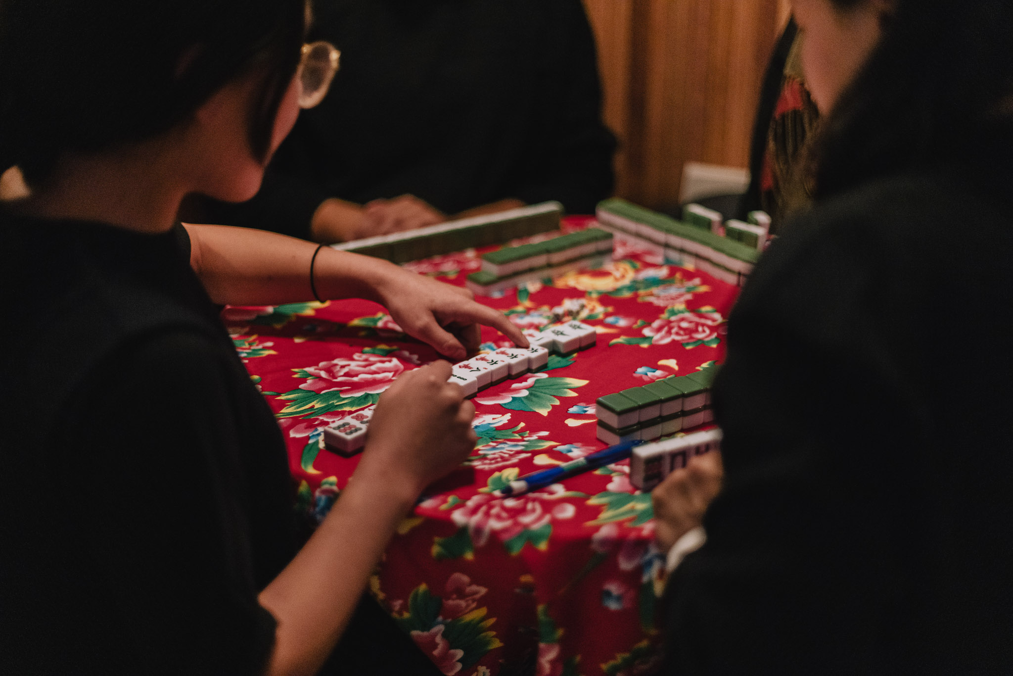 image of four people playing Mah Jong at the table