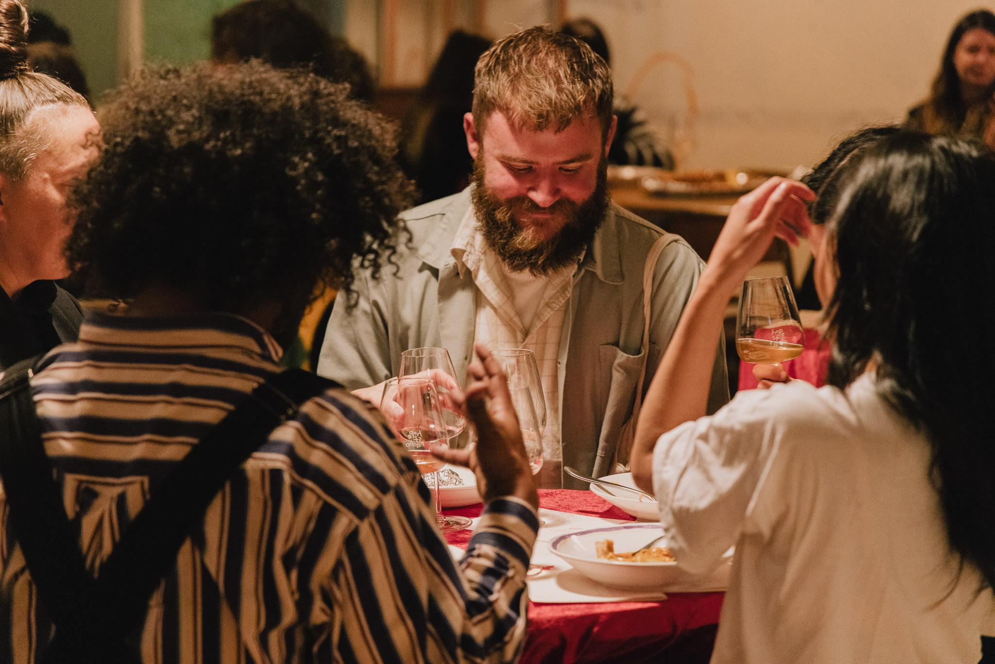 Image of three people eating dinner