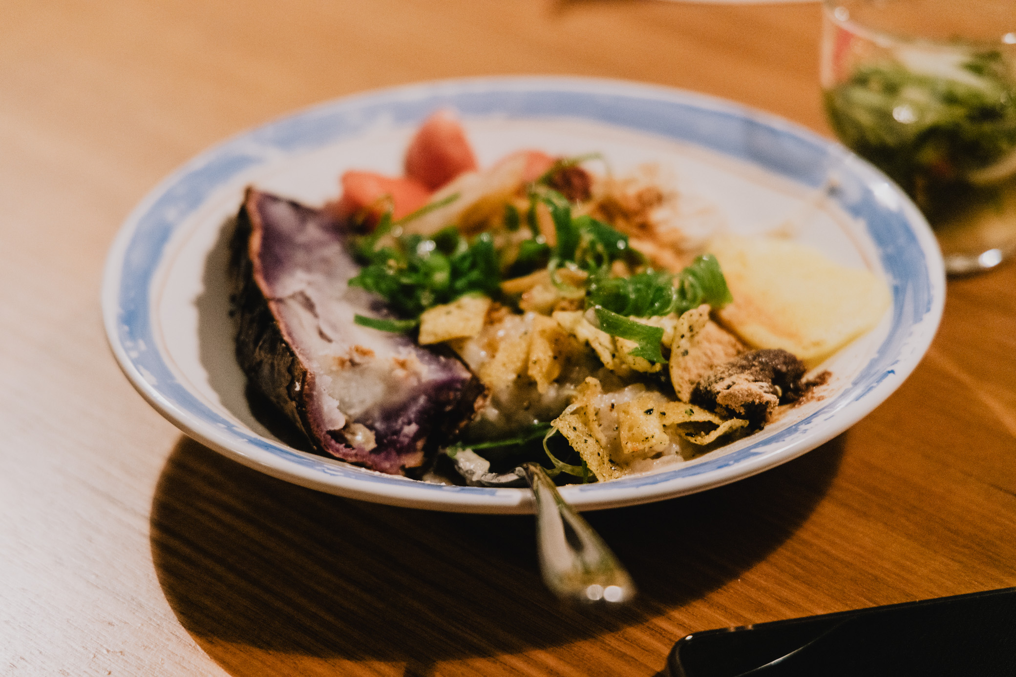 image of a bowl with savoury porridge featuring yam and fermented foods